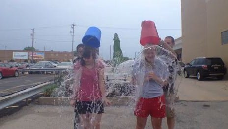 Post-Crescent Media writers Ariel Cheung (left) and Jen Zettel accepted the ALS Ice Bucket Challenge on Monday in Appleton.