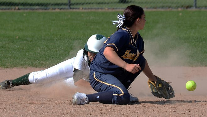Veronica Pezzoni (sliding) and the Howell offense had another big day at the plate to beat Hartland and Bri Robeson (crouching).