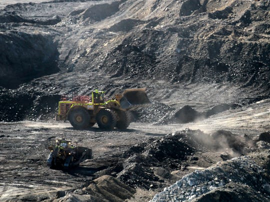 A bulldozer shovels coal in March at the Dixon Pit at the Navajo Mine in Fruitland.