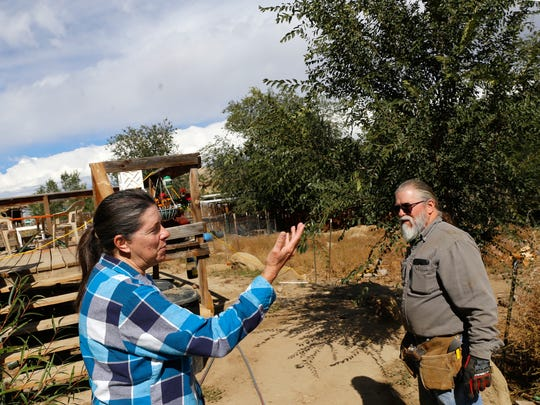 Tim and Peggy Hogan talk about the shortcomings of their water utility on Tuesday at their home off County Road 4904 in the Harvest Gold subdivision east of Bloomfield.