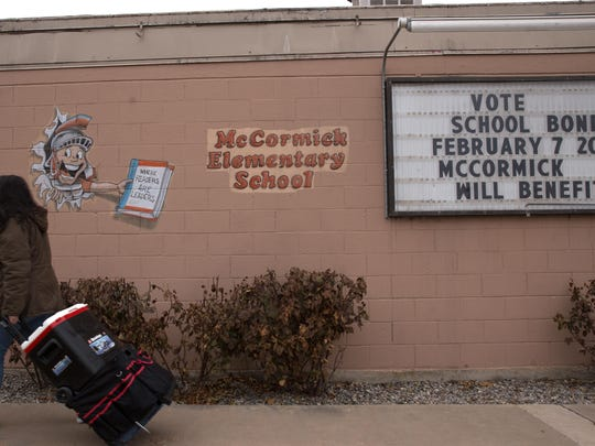 A sign on Jan. 19 alerts voters about an upcoming school bond election at McCormick Elementary School in Farmington.