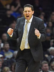 Coach Bryce Drew shouts encouragement to his team as