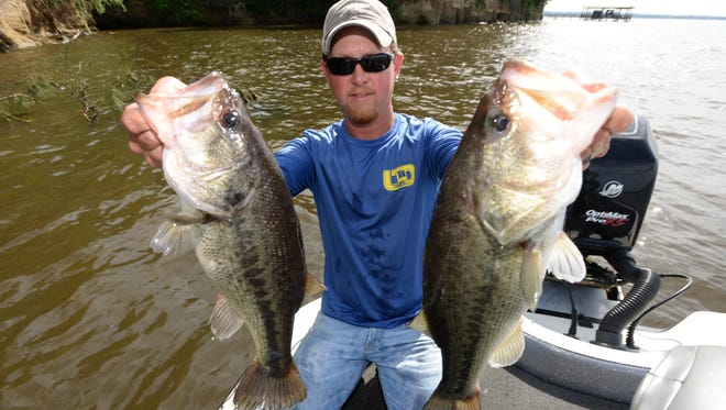 Brandon Baker of Living the Dream Guide Service shows off a pair of big bass caught on Toledo Bend.