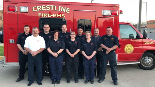 From left, front, areChief Steve Krock, Michele Johnnson, Katie Shepherd, Vicki Lash andCaptain Doug Manring; and back,Kyle Johnson, Tyler Furry, Cory Church, Scott Taylor andKeith Neale.