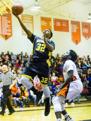 Wicomico guard Jordan Brittingham (32) goes for a lay up against Easton on Friday, Feb. 26 in the first round of the MPSSAA playoffs at Easton.