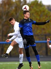 Zanesville's Jack Thorne goes up for a header against a River View defender during the first half of their Division II district final game on Saturday at the Maysville Athletic Complex.