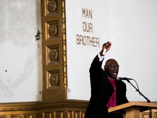 Bishop E. Lynn Brown, retired presiding prelate of the CME Church, delivers a passionate speech during the Clayborn Reborn Blessing Ceremony at Clayborn Temple on Tuesday. The historic site is currently being revitalized in Downtown Memphis. The church, located at 294 Hernando St., was built in 1892 and belonged to Second Presbyterian Church until they sold it to the African Methodist Episcopal Church in 1949. It was abandoned and boarded up for good in 1999. Neighborhood Preservation Inc. Clayborn Temple LLC purchased the church last October from the AME church for $65,000, according to the Shelby County assessor of property.