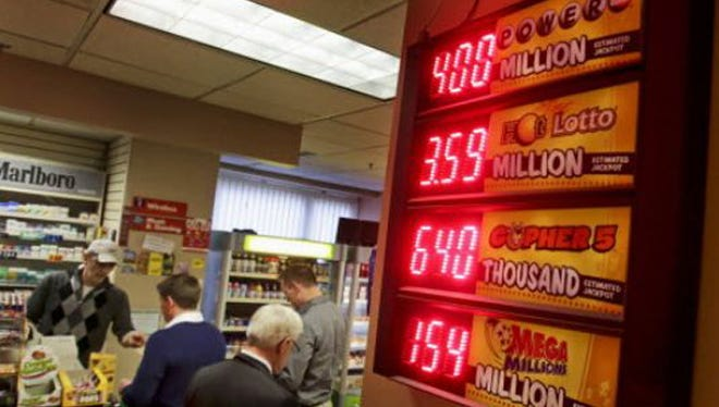 The $400 million Powerball jackpot tops the list of lottery payouts in this convenience store in Minneapolis on Feb. 18.