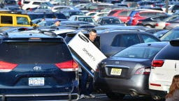 Shopper carrying flat-screen television at Garden State Plaza Mall in Paramus last year.