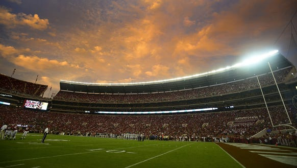 The sun sets at Bryant-Denny Stadium during the Alabama/Colorado