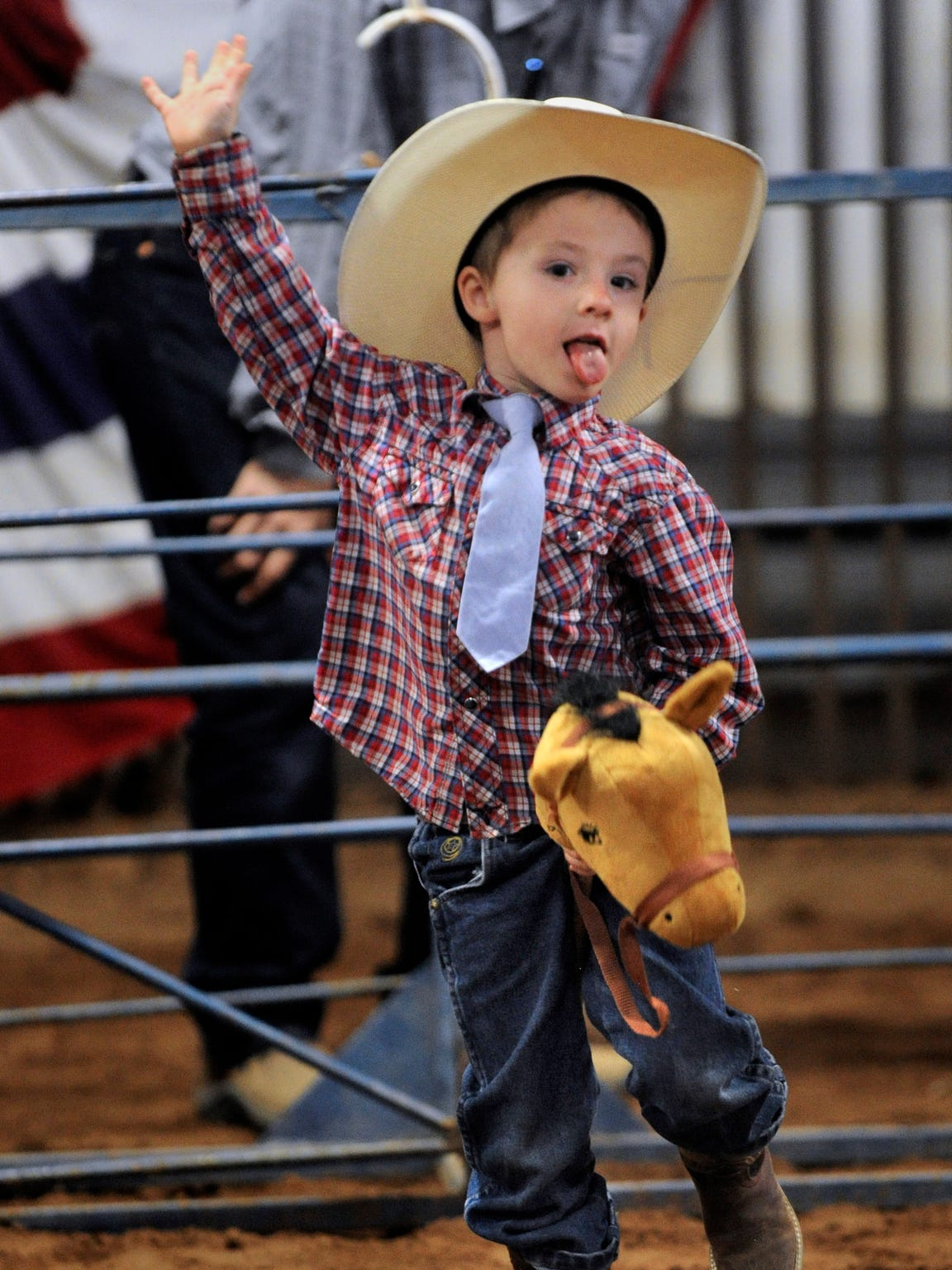 A youngster rides a fiercely buckin' bronc during the Stickhorse Rodeo at WHC.
