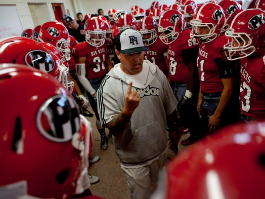 Port Huron assistant coach Dave Tatti talks with players in the locker room before a football game August 29, 2014 at Port Huron High School.