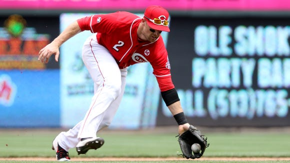 Cincinnati Reds shortstop Zack Cozart (2) fields a grounder from the San Diego Padres' Wil Myers in the 7th inning at Great American Ball Park Sunday, June 26, 2016. The Reds won 3-0.