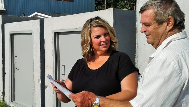 Recent Iowa tornado damage has increased phone calls at Wilkinson Precast, Inc., of Riverside.  Among many other concrete products, the company manufactures these family-size storm shelters, shown here with company founder Ken Wilkinson and his daughter, Lyndsay.