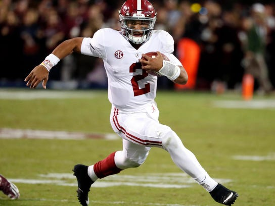 FILE - In this Saturday, Nov. 11, 2017, file photo, Alabama quarterback Jalen Hurts carries for a short gain against Mississippi State during the second half of an NCAA college football game in Starkville, Miss. Georgia plays Alabama in the Monday, Jan. 8, 2018, College Football national championship game. (AP Photo/Rogelio V. Solis, File)