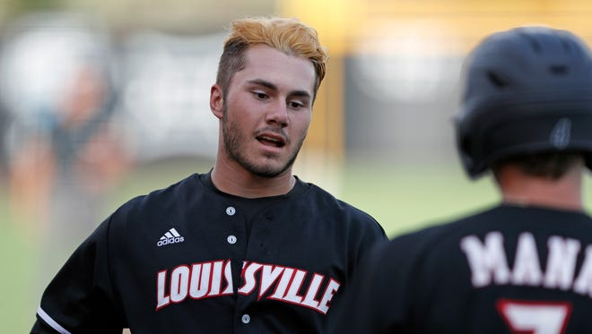 Louisville's Logan Wyatt (43) reaches home plate after hitting a three-run home run during an NCAA college baseball tournament regional game against Kent State, Friday, June 1, 2018, in Lubbock, Texas. (Brad Tollefson/Lubbock Avalanche-Journal via AP)