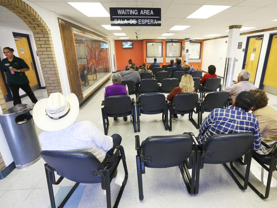 People sit in La Fe Clinic's waiting area Tuesday.