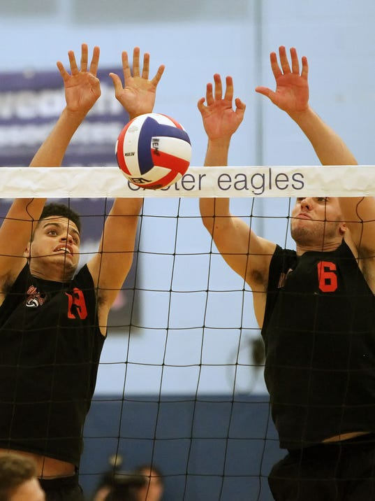 Hempfield's Ethan Williams (19) and Tyler Buterbaugh (6) go up for the block against Parkland during Tuesday's PIAA Class AAA volleyball semifinal at Exeter Township. Parkland won, 3-1.