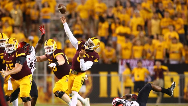 Arizona State Sun Devils quarterback Manny Wilkins (5) throws a touchdown pass against the San Diego State Aztecs in the fourth quarter at Sun Devil Stadium.