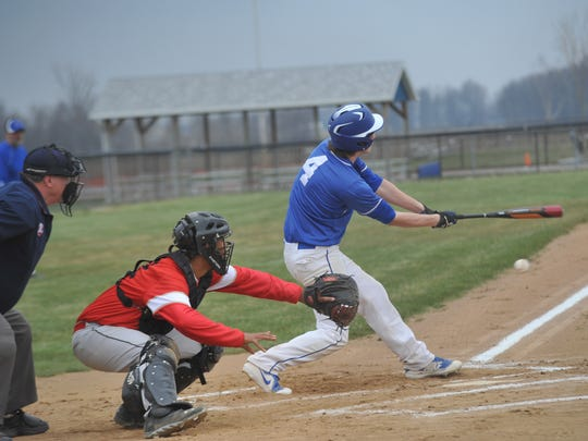 Crestline's Ty Clark swings at a pitch against Delaware Christian.