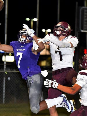 Opelousas Catholic wide receiver Devin Thierry fights for a pass despite coverages from a Vermilion Catholic defender on Friday night at Donald Gardner Stadium. The Vikings defeated VC 22-6 in the contest between two high-powered Class 1A teams.
