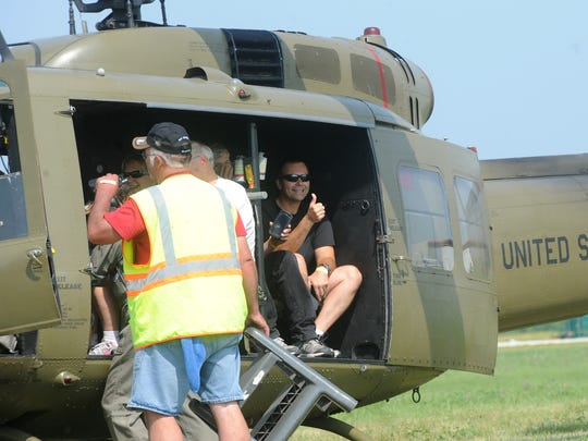 Rick Mackie of Fond du Lac gives a thumbs up before his ride on a Huey helicopter Aug. 2 at the Fond du Lac County Airport. Mackie's brother, Tom, who recently died of cancer, flew Hueys in Vietnam in 1970 and 1971.