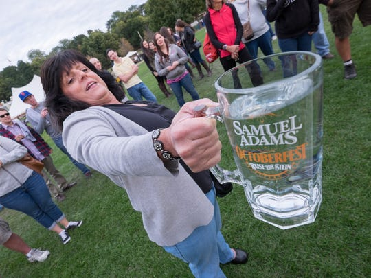 Angie Norris of Burlington holds onto her beer mug