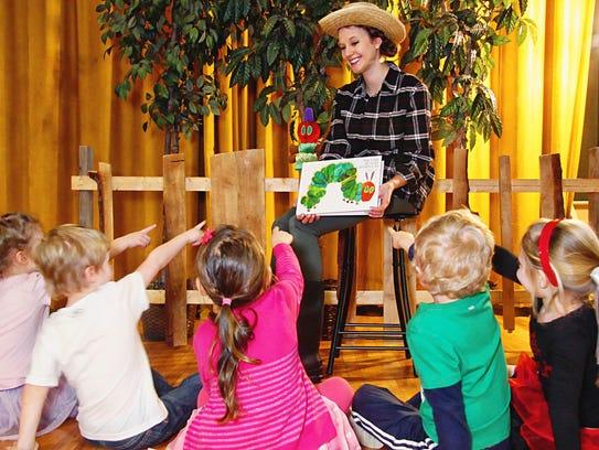 JCC Youth Director Lynette Errantte reads to preschool
