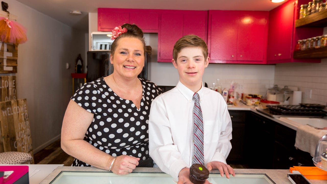 John Truel, 12, with the help of his mother, Patricia Puskas Truel, opens Cupcakes on 8th in Marshfield, Wis.