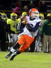 Beech High sophomore quarterback Nelson Smith rolls