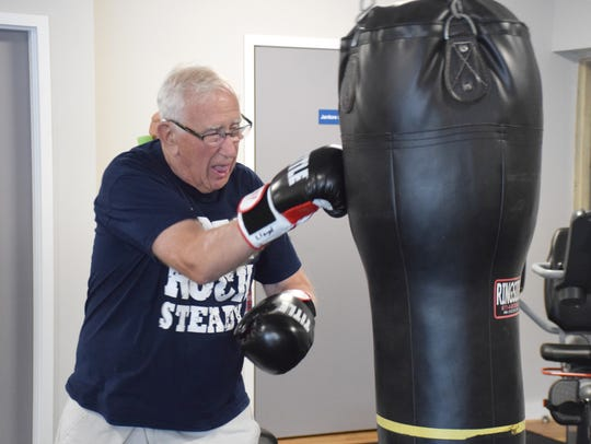 Participant Lloyd Delvaux hits the heavy bag during