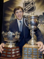 Pavel Datsyuk poses with the Frank Selke Trophy, awarded