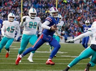 Buffalo Bills quarterback Josh Allen runs the ball in for a touchdown during the second half against the Miami Dolphins, one of his eight rushing touchdowns on the season.