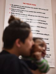 A Born Free resident kisses the cheek of a child at the rehabilitation center for pregnant women in Clinton.