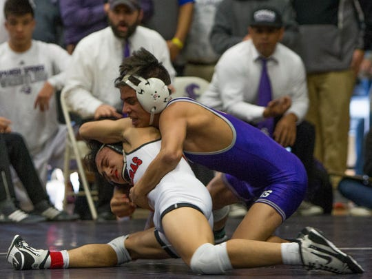 Spanish Springs' Jacob Ruiz, right, defeated Las Vegas High Schools' Antonio Saldate in the 120 pound division of the 4A Nevada State Wrestling Championships held on Saturday,  at Spanish Springs.