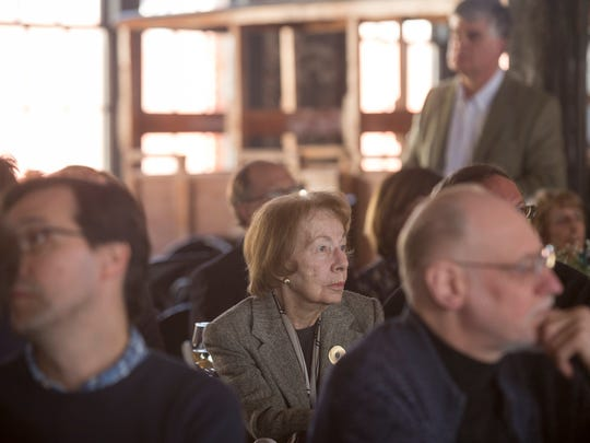 Gloria Whelan watches a short film during the Piquette Heritage Day on Sunday, April 8, 2018 at the Ford Piquette Avenue Plant in Detroit. Whelan's grandfather Carl Kilwinski painted the Ford Piquette Avenue Plant when it was first built in 1904.
