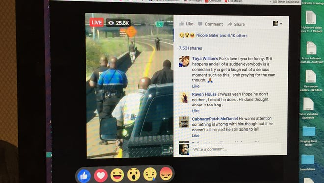 A man in this photo taken of a Facebook Live video is walking back and forth on an Interstate 20 overpass in Jackson.
