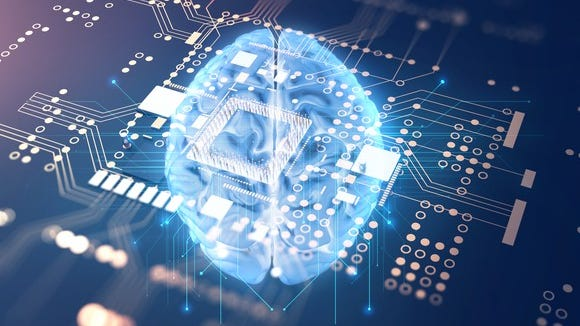 Image of a brain superimposed onto a computer motherboard.