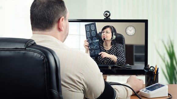 A man having a telehealth consultation with a doctor