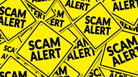 Lots of yellow diamond-shaped danger signs are criss-crossed, each saying scam alert.