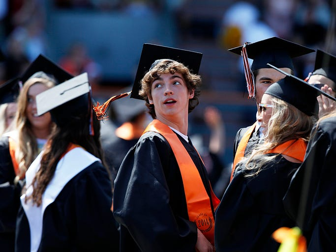 Dallas High School seniors attend their graduation at Gallaspy Stadium Saturday June 7, 2014.