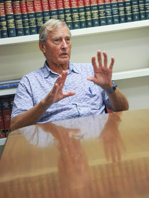 Attorney Ladd Baumann expresses his thoughts on the enforcement of current immigration laws and the deportation of convicted criminals by Gov. Eddie Calvo during an interview in Hagåtña on Monday, July 25.
