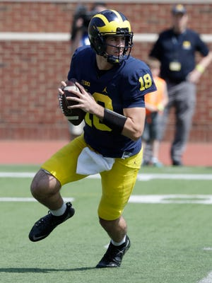 Brandon Peters moves out of the pocket in the spring game.