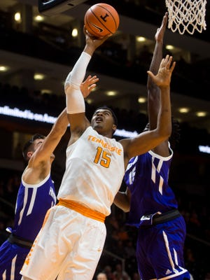 Tennessee forward Derrick Walker (15) attempts a shot Tuesday against High Point.