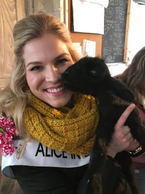 Alice in Dairyland Crystal Siemers-Peterman holds a newborn lamb.