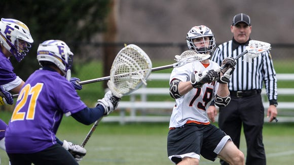 Palmyra senior Jared Richard winds up to rip a shot during the Cougars' 13-4 win over Ephrata on Monday, their first of the season.
