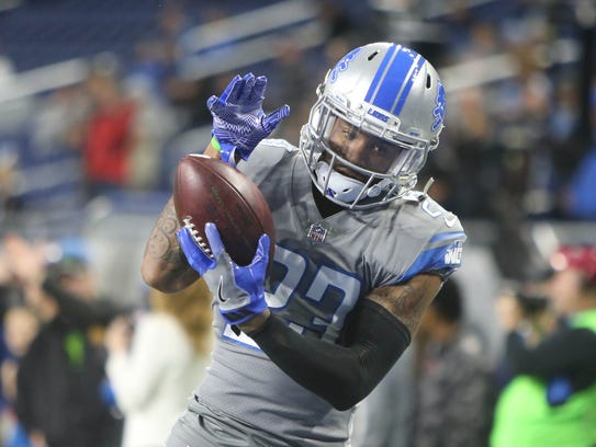 Detroit Lions' Darius Slay warms up before action against