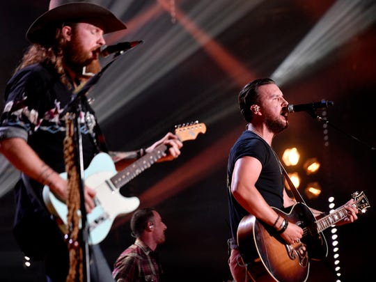 John Osborne, left, and T.J. Osborne of Brothers Osborne perform during the CMA Music Festival on June 11, 2017, at Nissan Stadium. They'll perform at the 2018 festival as well.