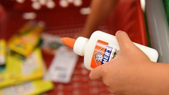 Choen Jensen, 6, shops for schools supplies at Target