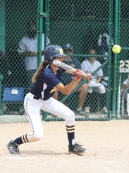 Hartland's Kelsey Zampa lays down a bunt that contributed